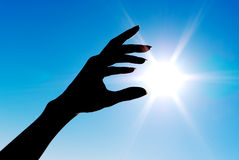 Touch to sun Stock Images