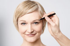 Touch up my eye shadow Stock Photography