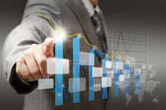 Touch virtual graph,chart. Businessman hand touch virtual graph,chart, diagram Stock Photo
