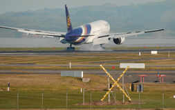 Touchdown!. Thai Airways Boeing 777 landing Royalty Free Stock Photos