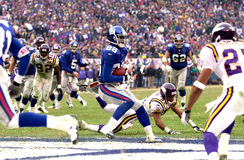 Touchdown Ike Hilliard. Wide Receiver Ike Hillard of the New York Giants scores a touchdown from a pass from New York Giants Quarterback Kerry Collins at the NFC Stock Photography