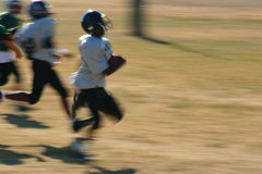 Touchdown run. Motion blur of a football player running the ball in for a touchdown Royalty Free Stock Photography