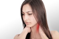 She touches the red dot with pain and suffers from chronic neck pain from hard work. Isolated on white background. She wants to tr. Eat pain. Concept office Stock Images