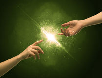 Touching arms lighting spark at fingertip Royalty Free Stock Photography