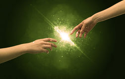 Touching arms lighting spark at fingertip Royalty Free Stock Image