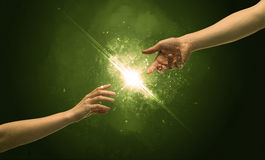 Touching arms lighting spark at fingertip Stock Photo