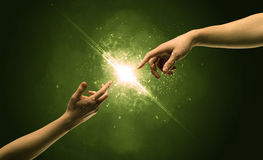 Touching arms lighting spark at fingertip Stock Image
