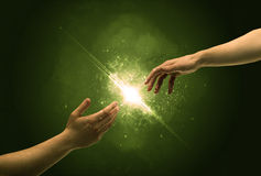 Touching arms lighting spark at fingertip Stock Photography