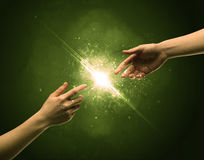 Touching arms lighting spark at fingertip Royalty Free Stock Images