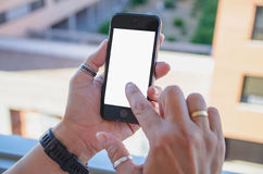 Touching blank mobile phone screen Royalty Free Stock Image