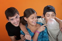 Touching a bubble from her brothers gum Stock Photo