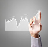 Touching business graph work Royalty Free Stock Images