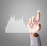 Touching business graph work. Touching business graph of work Stock Photo