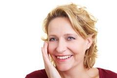 Touching the cheek. Happy woman touching her cheek with her hand Stock Photo