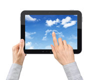 Touching Cloudscape On Tablet PC. Businessman hands are holding and point on contemporary tablet pc with cloudscape on screen. Concept on cloud-computing theme Stock Photography