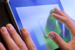 Touching digital tablet Royalty Free Stock Image