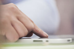 Touching digital tablet. Hand presses on screen digital tablet Stock Photography