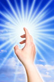 Touching divine light. Female hand touching divine light like a concept for hope, innocence Stock Photography