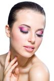 Touching face girl with bright makeup and closed eyes Royalty Free Stock Image