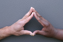 Touching fingers. A white man and black man touching fingers Royalty Free Stock Image