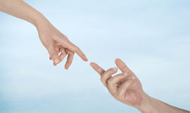 Touching fingers on sky background royalty free stock photos