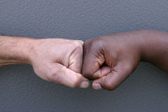 Touching fists Stock Photo