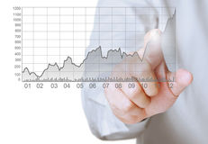 Touching graph of work. Businessman Touching graph of work Stock Photography
