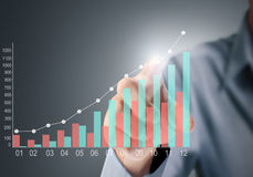 Touching graph of work Royalty Free Stock Photo