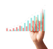 Touching graph of work. Businessman Touching graph of work Royalty Free Stock Image