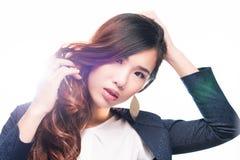 Touching hair Stock Image