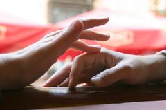Touching hands. Gentle touch of a hand Stock Images