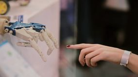 Touching hands of human and cyborg or The Creation of cyborg. stock video footage