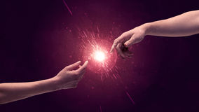 Touching hands light up sparkle in space Royalty Free Stock Image