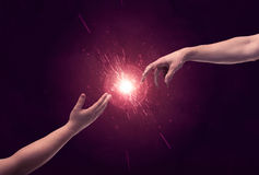 Touching hands light up sparkle in space Royalty Free Stock Photography