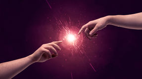Touching hands light up sparkle in space Stock Images