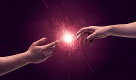 Touching hands light up sparkle in space. White caucasian male hands reaching out with fingers almost touching in bright red light sparkle in empty space