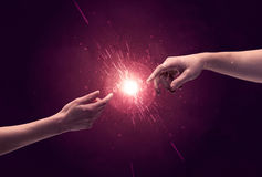 Touching hands light up sparkle in space Royalty Free Stock Images