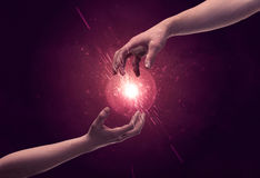 Touching hands light up sparkle in space Royalty Free Stock Photos