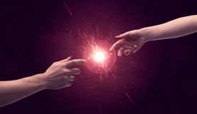 Touching hands light up sparkle in space Stock Photo