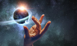 Touching planet with finger stock images