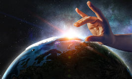 Touching planet with finger stock photos