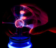 Touching a plasma lamp with five fingers Stock Photos