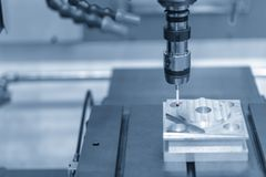 The touching probe attach on CNC machine setting the work pieces. royalty free stock photo