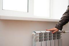 Touching the radiator Royalty Free Stock Photos