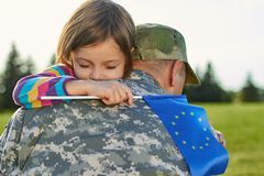 Touching reunion of little girl and father. royalty free stock images