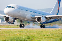Touching the runway with smoke. The plane lands. Touching the runway with smoke Stock Photography