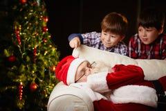 Touching Santa Stock Image