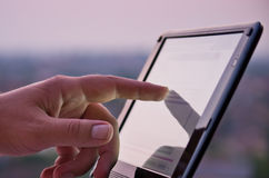 Touching screen on tablet Stock Photography