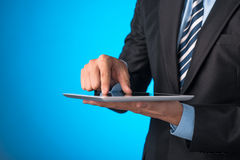 Touching Screen On Tablet PC. Man hand touching screen on modern digital tablet pc. Close-up image with shallow depth of field focus on finger Royalty Free Stock Photo