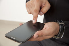 Touching a smart phone Stock Image